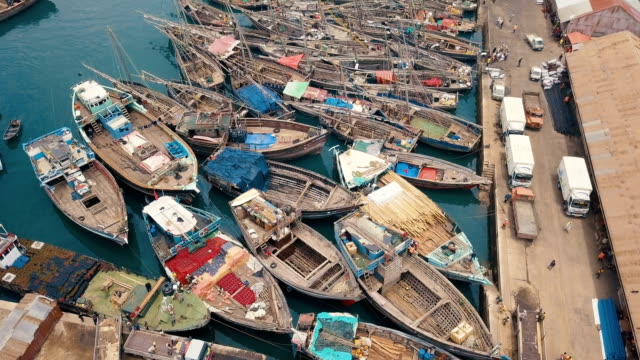 aerial vertical/ east african harbour with boats, ships and/ zanzibar stone town - zanzibar archipelago stock videos & royalty-free footage