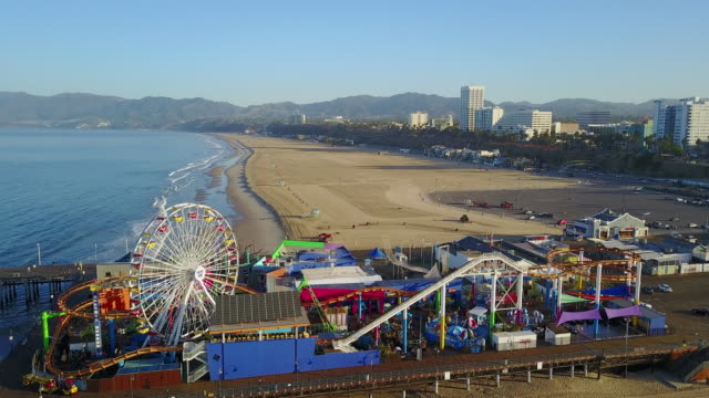 aerial: vertical elevation above the santa monica pier - サンタモニカ点の映像素材/bロール