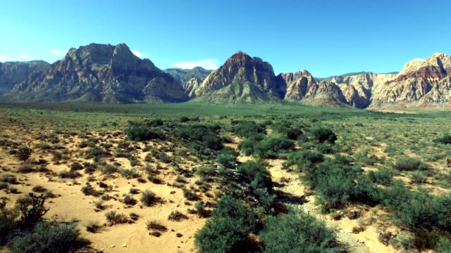 aerial vertical pan and track of red rock canyon in nevada. - red rocks stock videos and b-roll footage