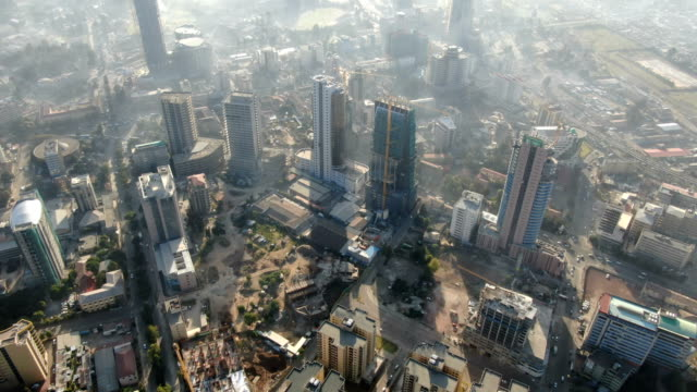 aerial vertical view of addis ababa downtown with fast growing buisness center/ ethiopia - アジスアベバ点の映像素材/bロール