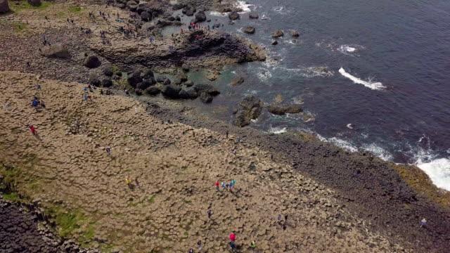 aerial vertical view of giant's causeway/ northern ireland - basalt stock videos & royalty-free footage