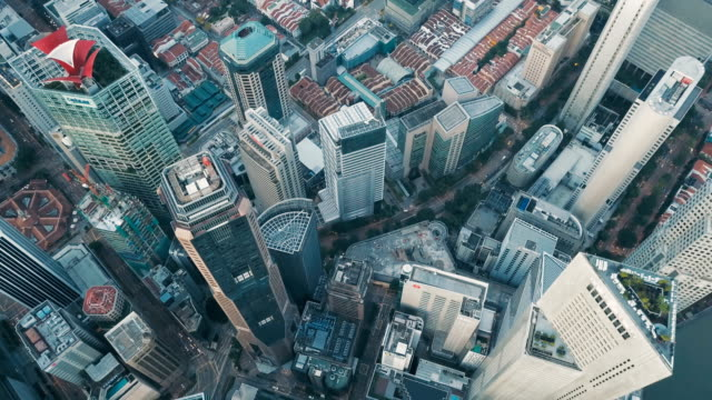 aerial vertical view of rooftop financial district buildings, singapore - development stock videos & royalty-free footage