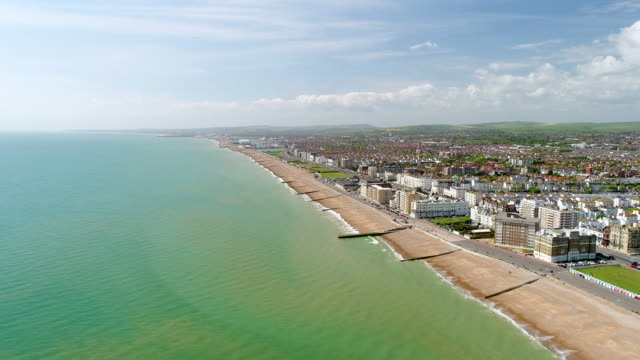 4k aerial video brighton seafront looking west towards hove - english channel stock videos and b-roll footage
