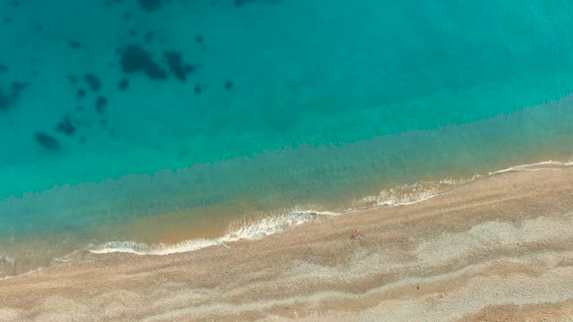 Aerial video: Clear water with algae on the seabed