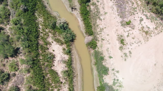 aerial video clip of the border with mexico, the rio grande river, without a border wall, near el paso, texas - fortress stock videos & royalty-free footage