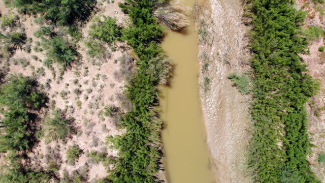 aerial video clip of the border with mexico, the rio grande river, without a border wall, near el paso, texas - valley stock videos & royalty-free footage