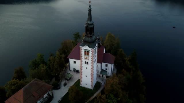 aerial video. flight over lake bled in slovenia - lake bled stock videos & royalty-free footage