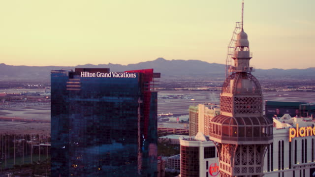 aerial video flying around paris las vegas, view off into distance, sunrise - other stock videos & royalty-free footage