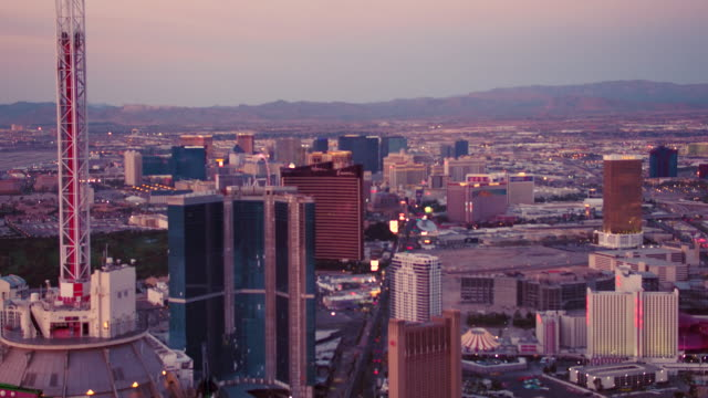 Aerial video flying close to top of Stratosphere Casino, Hotel & Tower, Las Vegas Sunset