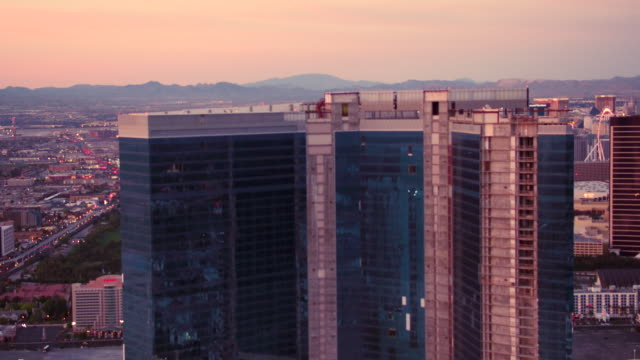 aerial video flying over north end of las vegas strip looking south, sunset - las vegas stock videos & royalty-free footage