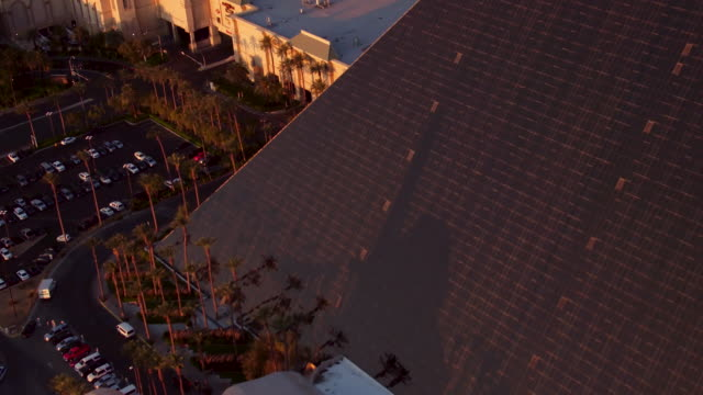 Aerial video flying over The Las Vegas Strip, Luxor Hotel & Casino, sunrise