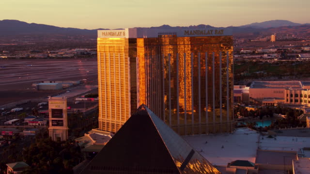 Aerial video flying over The Las Vegas Strip, McCarran International Airport (LAS), sunrise