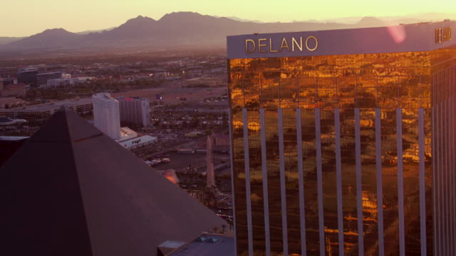 Aerial video flying over The Las Vegas Strip, view of Luxor, Mandalay Bay and Delano Las Vegas, sunrise
