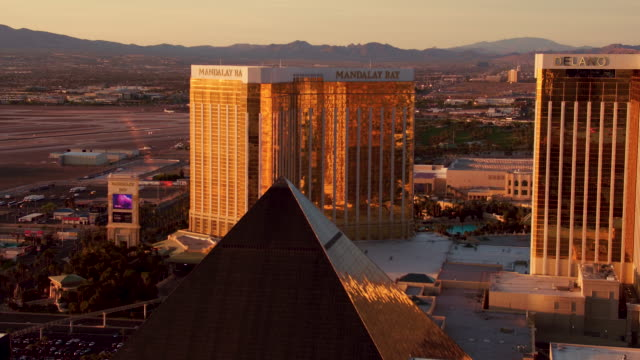 aerial video flying over the las vegas strip, view of luxor, mandalay bay and delano las vegas, sunrise - mandalay bay resort and casino stock videos & royalty-free footage