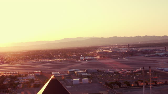 Aerial video flying over The Las Vegas Strip, view of McCarran International Airport (LAS), sunrise