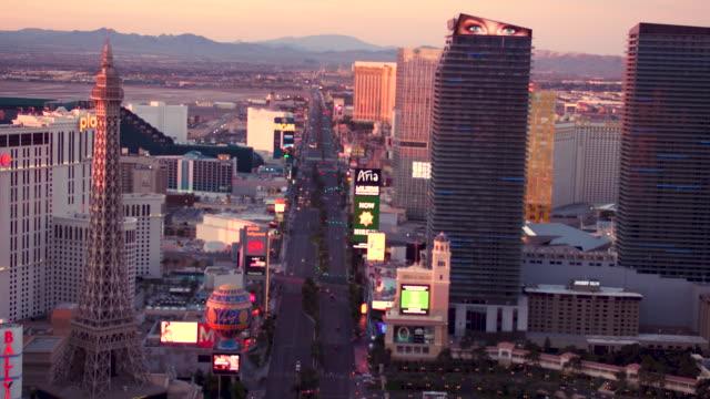 Aerial video flying South down The Las Vegas Strip, Sunrise