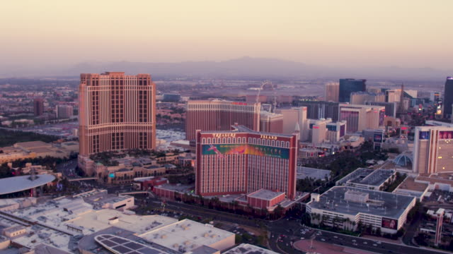 aerial video flying south down the las vegas strip, sunset - the mirage las vegas stock videos & royalty-free footage
