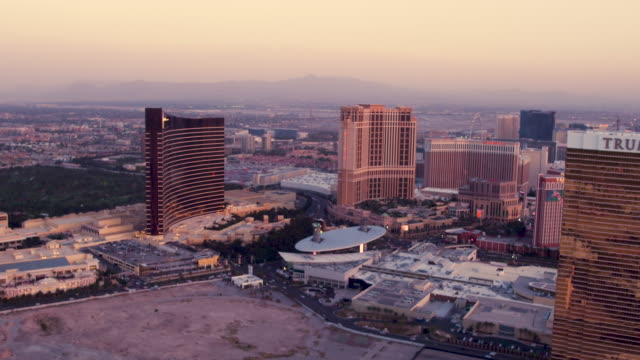 aerial video flying south down the las vegas strip, sunset - western script stock videos & royalty-free footage