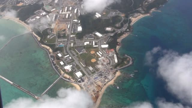 aerial video footage shows a walled off section of sea set for reclamation for building a new u.s. military base off the henoko district of nago,... - vessel part stock videos & royalty-free footage