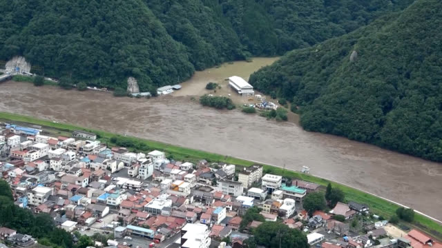 aerial video footage taken around noon on july 14 shows the extent of flooding in gotsu, shimane prefecture, after heavy rains swelled the gonokawa... - shimane prefecture stock videos & royalty-free footage