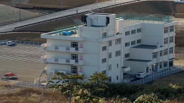 aerial video footage taken by drone in wakabayashi ward of sendai shows the former arahama elementary school which was submerged up to its second... - 地震点の映像素材/bロール