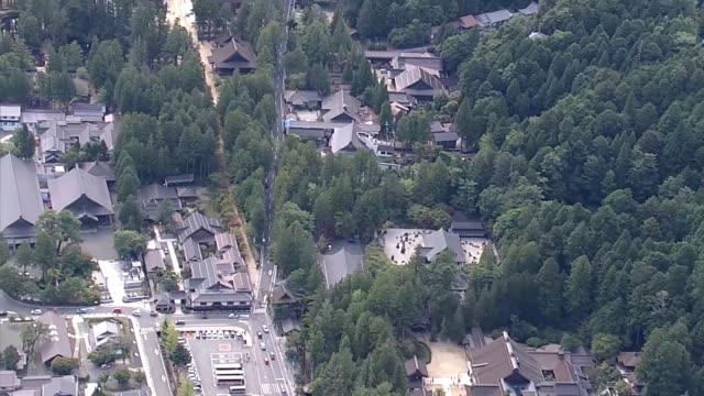 aerial video footage taken in wakayama prefecture shows mount koyasan considered the spiritual center of the shingon branch of esoteric buddhism... - スピリチュアル点の映像素材/bロール