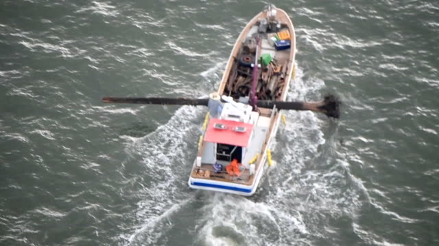 aerial video footage taken on july 23 from above the ariake sea shows some of the scores of fishing boats joined in a largescale operation to clear... - ariake sea stock videos and b-roll footage