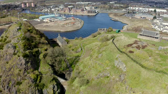 aerial video from drone of dumbarton castle in dumbarton, scotland, uk - scottish culture stock videos & royalty-free footage