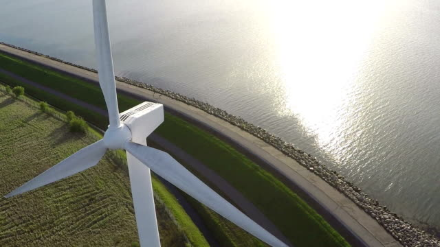 aerial video from wind generator / wind turbine - power line stock videos & royalty-free footage