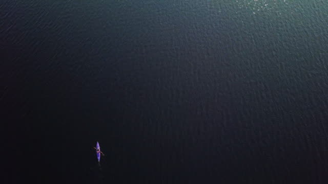 4K Aerial Video Healthy Woman Kayaking at Sunrise on Lake