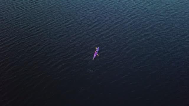 4K Aerial Video Healthy Woman Kayaking at Sunrise on Lake