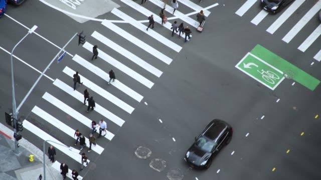 aerial video of a busy la intersection/crosswalk - 4k footage - pedestrian stock videos & royalty-free footage