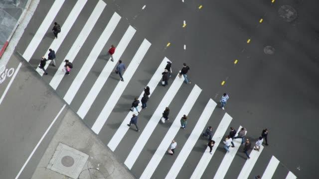 aerial video of a busy la intersection/crosswalk - 4k footage - zebra crossing stock videos & royalty-free footage