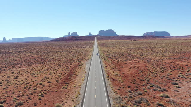 vidéos et rushes de aerial video of american highway in the desert, arizona - drone footage - route 66