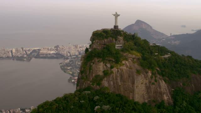 Aerial video of Art Deco Statue, Lagoa, and Rio de Janeiro.