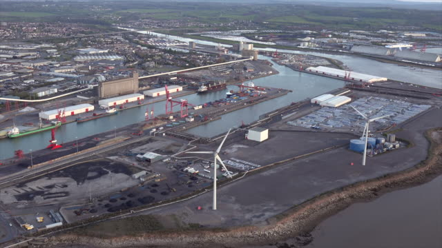 aerial video of avonmouth docks with the river avon. bristol, uk. - bristol england stock videos and b-roll footage