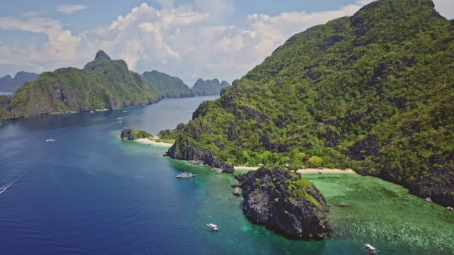 aerial video of boats in star beach, palawan, philippines - filippine video stock e b–roll
