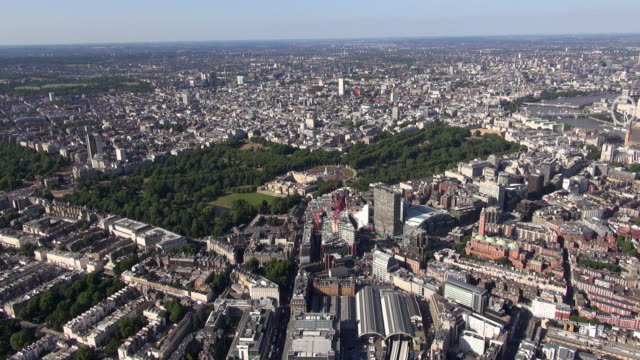 aerial video of buckingham palace and surrounding areas including victoria and westminster, st james's park and green park and views east over central london and river thames - surrounding stock videos and b-roll footage