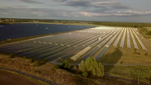 aerial video of clean solar energy plant in germany - plant process stock videos & royalty-free footage