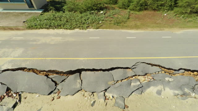 aerial video of coastline road damaged - eroded stock videos & royalty-free footage