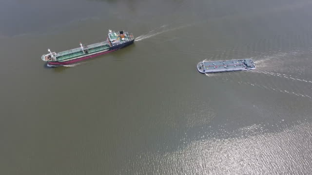 Aerial Video of Containers Ships Sailing in the River