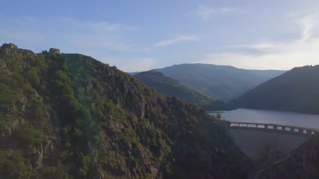 vidéos et rushes de aerial video of flood barrier and lake of villefort, cevennes, france , 2018 august - barrage