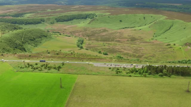 aerial video of hole of horcum tracking left to right-north york moors national park - hole stock videos and b-roll footage