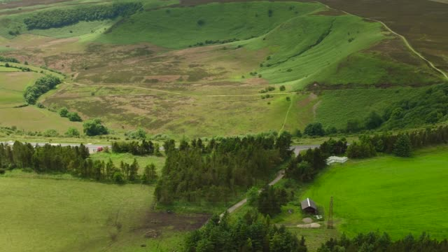 aerial video of hole of horcum tracking right to left-north york moors national park - hole stock videos and b-roll footage