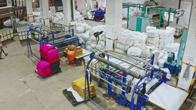 aerial video of indian people working at textile factory - mill stock videos & royalty-free footage