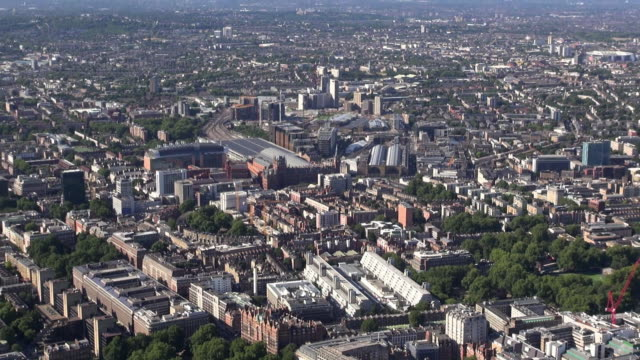 aerial video of kings cross and st pancras stations and bloomsbury, zooming out to show surrounding areas and distant views over north london and beyond - surrounding stock videos and b-roll footage