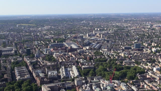 aerial video of kings cross station, st pancras international station and bloomsbury, with views over coram's fields, north london and beyond, zooming in towards the stations and surrounding area - north stock videos and b-roll footage