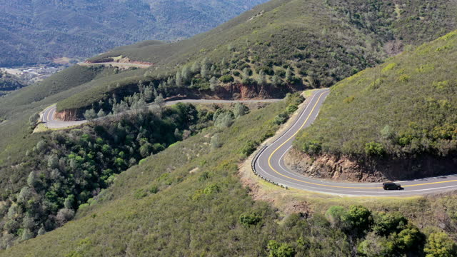 aerial video of mountain pass road - drone footage - mountain road stock videos & royalty-free footage
