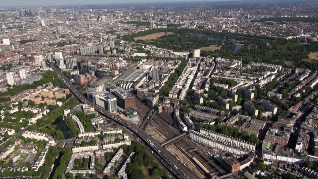 Aerial video of Paddington Basin and Paddington Station with a backdrop of Hyde Park and central London looking south east