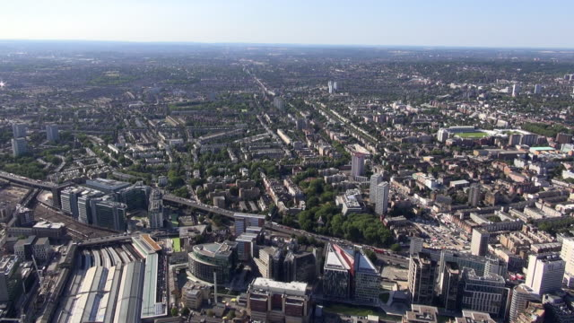 Aerial video of Paddington Station and Paddington Basin with views over A40 Westway and Edgware Road to Maida Vale, St John's Wood and Lord's Cricket Ground